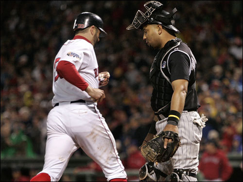 Jason Varitek (left) scored on a walk in the fifth inning.