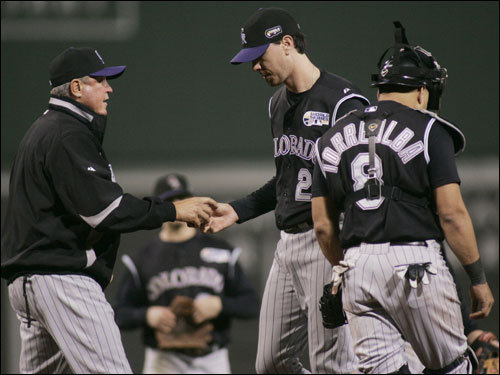 Ryan Speier (center) was pulled by Rockies manager Clint Hurdle (left) in the fifth inning.