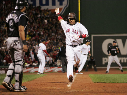 Manny Ramirez scored on a single off the bat of J.D. Drew (not pictured) in the fifth inning.