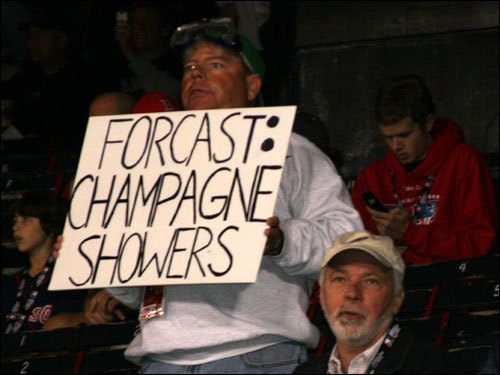 Red Sox players sipped champagne after clinching a playoff spot, winning the AL East, beating the Angels in the ALDS, and coming back on Cleveland to win the pennant. A fan predicts there will be one more champagne shower at Fenway.