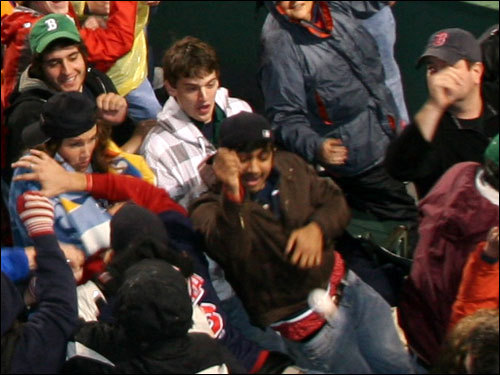Fans scrambled for a baseball tossed into the center field bleachers between innings.