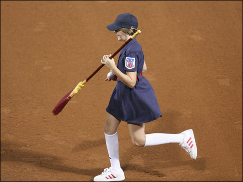 A ball girl swept the bases between innings during Game 1.