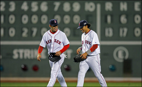 Outfielders Jacoby Ellsbury (left) and Coco Crisp had a chuckle as they came off the field following the final out of the game.