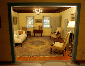 The house, built by a cousin of President James Garfield, was supposedly inhabited for more than two centuries by the ghost of Old Moll Garfield the Witch. Shown here, the home's elegant living room.