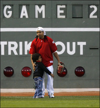 Manny Ramirez was hugged by his son Manny Jr. during the Red Sox batting practice before Game 2 of the baseball World Series against Colorado Rockies.