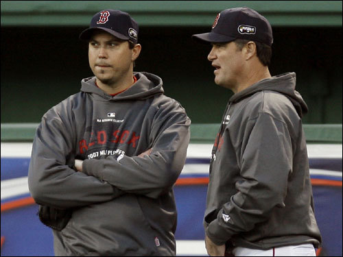 Game 1 winner Josh Beckett (left) and pitching coach John Farrell (right), spoke during warmups before the game.