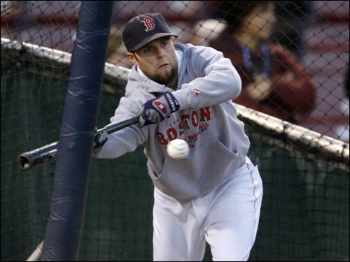 Red Sox second baseman Dustin Pedroia bunted during batting practice before the game.