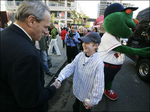 President/Chief Executive Officer Larry Lucchino shook hands with Andrew Madden before the game.