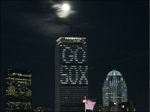 The moon rose over the Prudential Center in Boston before the start of Game 2 of the World Series.