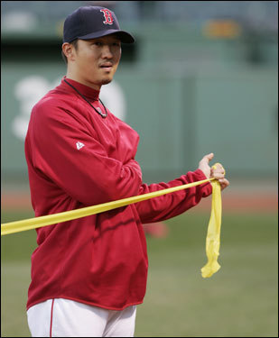 Red Sox reliever Hideki Okajima stretched out before the game.