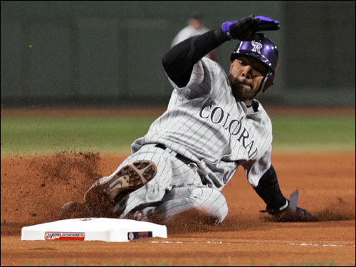 After being hit by a pitch, Rockies leadoff man Willy Taveras took third base on a single by Matt Holiday in the first inning.