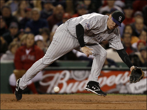Rockies third baseman Garret Atkins gloved a ball hit by Mike Lowell (not pictured) in the second inning.