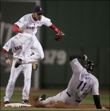 Red Sox shortstop Julio Lugo (left) turned a doubleplay in the second inning.