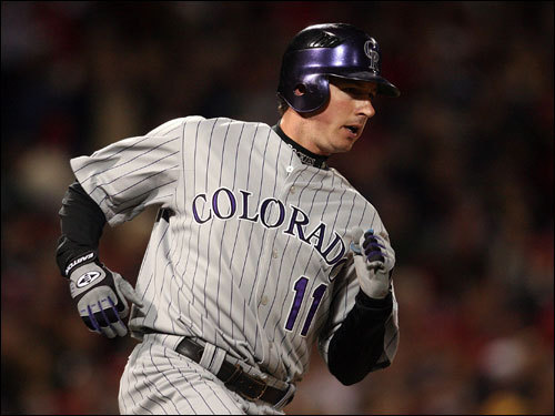 The Rockies Brad Hawpe rounded first on a second inning single.