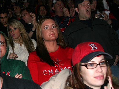 Ashley Papelbon (center) watched in anticipation as her husband Jonathan Papelbon took the mound in the eighth inning of Game 2 Thursday night. The big closer picked up the four-out save and the Sox head to Colorado up 2-0 in the Series.