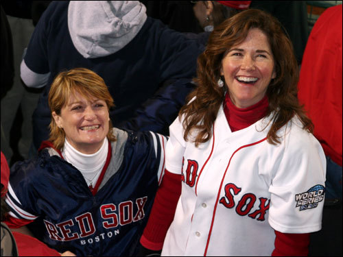 Liz Taber (left), from Providence, R.I., and Mary Alive Prescott, from Charlotte, N.C., cheered as they watched the Red Sox come back to beat Cleveland on the center field monitor before the start of Game 2.