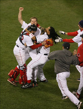 Red Sox teammates swarmed pitcher Jonathan Papelbon in celebration after defeating the Cleveland Indians in Game 7 of the American League Championship Series. With the victory Boston moved on to face the Colorado Rockies in the 2007 World Series.