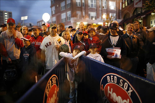 Fans gathered to enter into Fenway Park before the first game of the World Series on Wednesday.