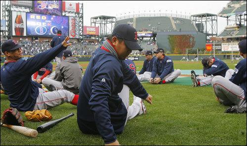 Game 3 starter Daisuke Matsuzaka did some stretching.