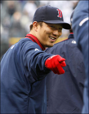 Red Sox reliever Hideki Okajima pointed to another player on the field.