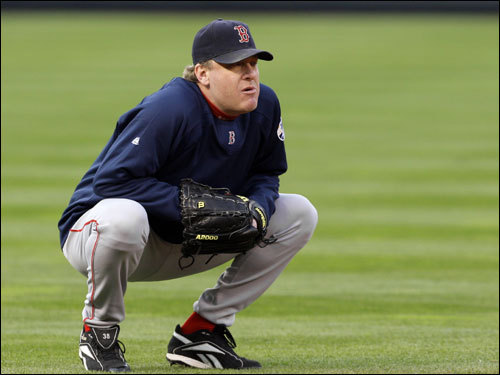 Game 2 winner Curt Schilling crouched on the field before the game.