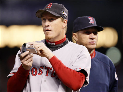 Red Sox relivers Mike Timlin (left) used his video camera before the game.