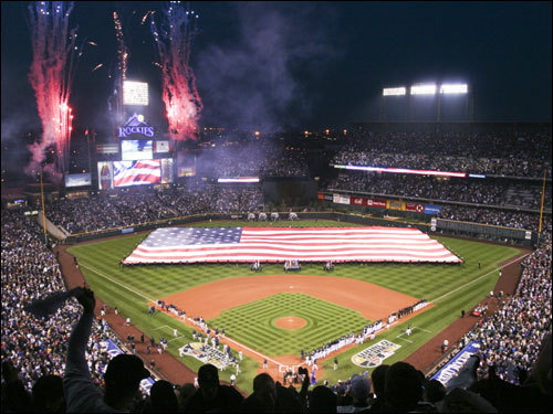 A shot of pregame ceremonies at Coors field.