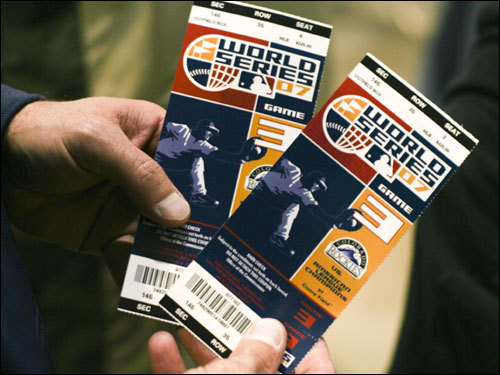 A fan held a pair of World Series tickets for Game 3.
