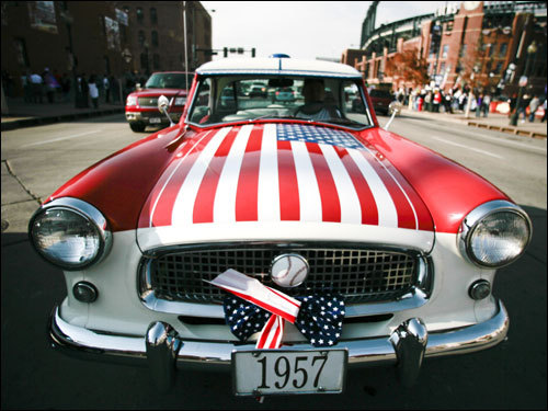 Tom Hall drove around his customized 1957 vintage car before the game near Coors Field in Denver, Col.