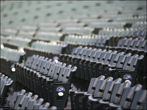 The seats at Coors field were empty earlier in the day.