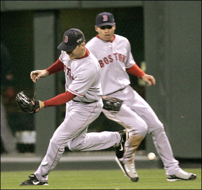 J.D. Drew (left) made an error on a single by Kaz Matsui (not pictured) in the first inning.