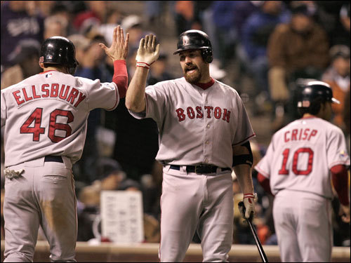Jacoby Ellsbury (left) and Kevin Youkilis (center) celebrated the Red Sox scoring in the eighth inning.