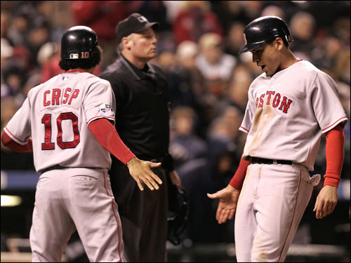 Coco Crisp (left) and Jacoby Ellsbury (right) celebrated scoring in the eighth inning.