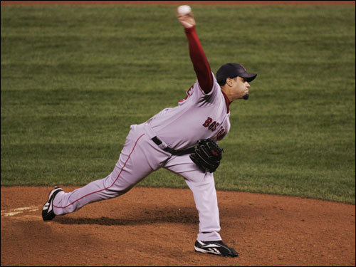 Red Sox reliever Manny Delcarmen delivered a pitch in the eighth inning.