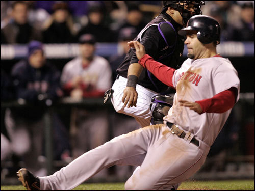 Mike Lowell slid into home plate with the 10th Red Sox run in the ninth inning.