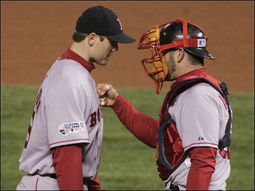 Jonathan Papelbon (left) was encouraged by Jason Varitek (right) after coming into the game in the eighth inning.