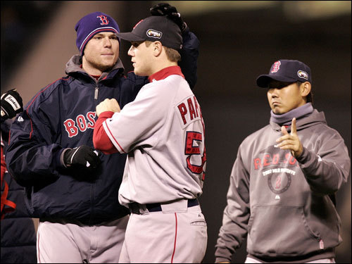 Game 4 starter Jon Lester (left), Jonathan Papelbon (center), and Game 3 winner Daisuke Matsuzaka (right) celebrated the victory on the field.