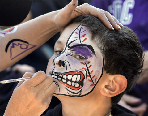 Rockies fan Jaret Olson got his face painted outside Coors Field before Game 4.