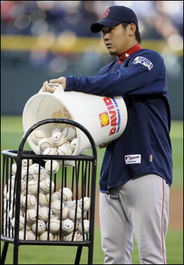 Game 3 winner Daisuke Matsuzaka helped out with batting practice before Game 4.