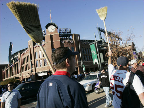 Bob Kiley, of Brockton, and Dave Oliver, of Amherst, brought their brooms to the ballpark for Game 4.