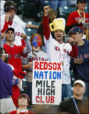Red Sox fans showed their spirit during warm-ups at Coors Field in Denver.