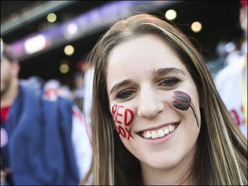 A Red Sox fan had a broom painted on her face in hopes of a sweep by the Red Sox .
