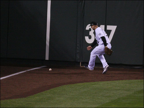 Rockies left fielder Matt Holliday chased down the double off the bat of Jacoby Ellsbury.