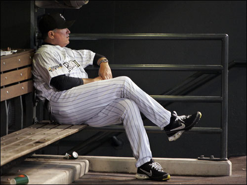 Rockies manager Clint Hurdle sat alone in the dugout in the first inning.