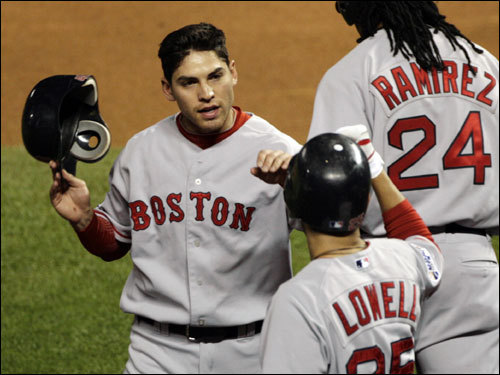 Jacoby Ellsbury (left) and Mike Lowell celebrated the first Red Sox run of the game.