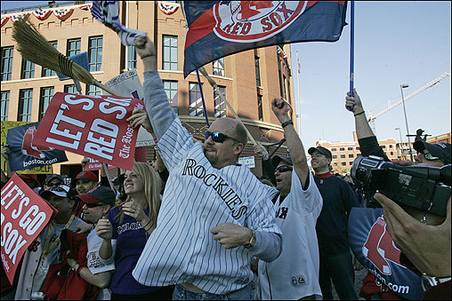 Rockies fan Chuck Willson (center) of Denver mingled with Red Sox fans outside Coors Field before Game 4 of the World Series.