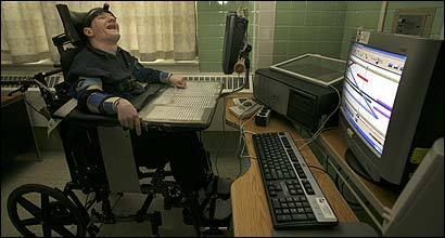 Dan Ellsey, a patient with cerebral palsy at Tewksbury Hospital, enjoys the liberating effects of being able to compose his own music using a special computer program.