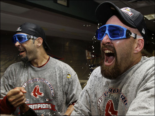 Mike Lowell (left) and Kevin Youkilis celebrated in the clubhouse.