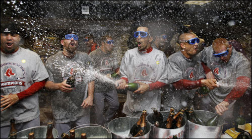 Red Sox players celebrated the World Series Championship by spraying champagne in the clubhouse.