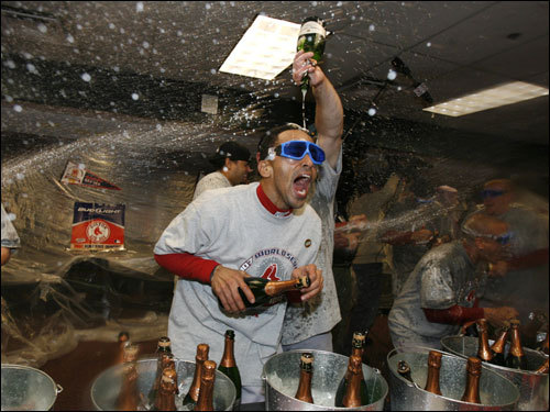 Sox shortstop Julio Lugo sprayed champagne during celebrations in the clubhouse.